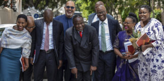 South Africa's Finance Minister Tito Mboweni presents his mid-term budget